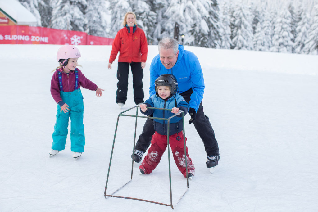 peak of christmas grouse mountain family skating